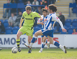 COLCHESTER, ENGLAND - Saturday, April 24, 2010: Tranmere Rovers' Ian Thomas-Moore and Colchester United's David Prutton in action during the Football League One match at the Western Community Stadium. (Photo by Gareth Davies/Propaganda)