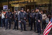A contingent of New York City police officers standing in front of Trump Tower on New York's Fifth Avenue the Saturday before the November 2017 election
