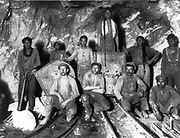 Black, Chinese, and White labourers in a gold mine in South Africa, c1900.
