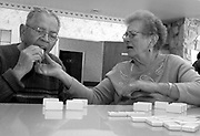 Fabiola Trejo stops her husband Robert from eating a domino while visiting him at his care facility in Hayward, Calif. Jan. 17, 2007. Robert was diagnosed with Alzheimer's disease in 2002, and Fabiola cared for her husband of over 60 years alone in their home for over four years before he suffered a fall and had to be admitted to the care facility.