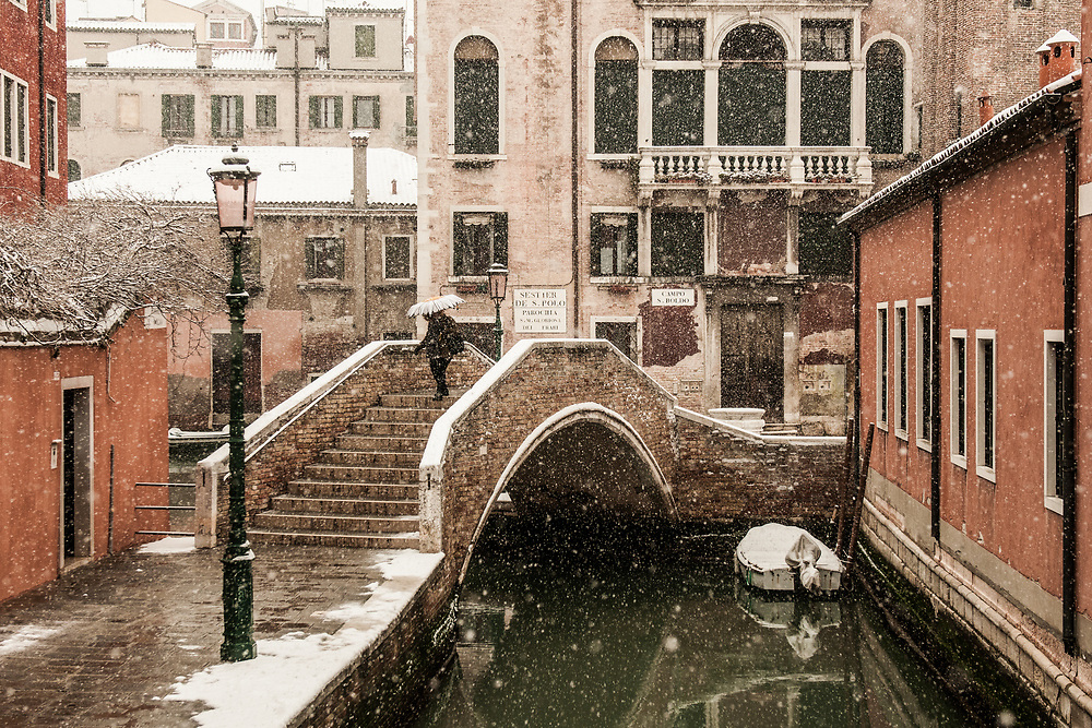 VENICE, ITALY - 28th FEBRUARY/01st MARCH 2018<br /> A woman crosses a bridge during a snowfall in Venice, Italy. A blast of freezing weather called the &ldquo;Beast from the East&rdquo; has gripped most of Europe in the middle of winter of 2018, and in Venice A snowfall has covered the city with white, making it fascinating and poetic for citizen and tourists.   &copy; Simone Padovani / Awakening