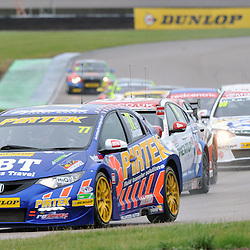 Andrew Jordan, British Pirtek Racing(Honda Civic) leading the pack round.<br /> Taken during Round 8 (Race 1) of the MSA British Touring Car Championship at the Rockingham Circuit, Northamptonshire on the 15th September 2013.<br /> WAYNE NEAL | SPORTPIX.ORG.UK