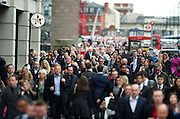 Commuters walk over London Bridge heading towards the city in London UK on May 14th 2012..Transport for London (TfL) and Network Rail are encouraging those travelling during Olympic  Games-time to make short journeys on foot as Living Streets Walk to Work Week launches. ..Photo/ Ki Price ..........