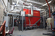 The biomass boiler at the University Hospital of South Manchester NHS Foundation Trust (UHSM) By investing money to save energy and winning the hearts and minds of staff, UHSM has achieved reduction a reduction of more than 35% in electricity and gas use over the past five years, this year saving some £390,000 on fuel bills. With new technologies such as biomass boilers, heating system upgrades, new lighting, windows and insulation combined with staff behaviour change, the hospital's logical approach to retrofit is eminently replicable across the NHS.