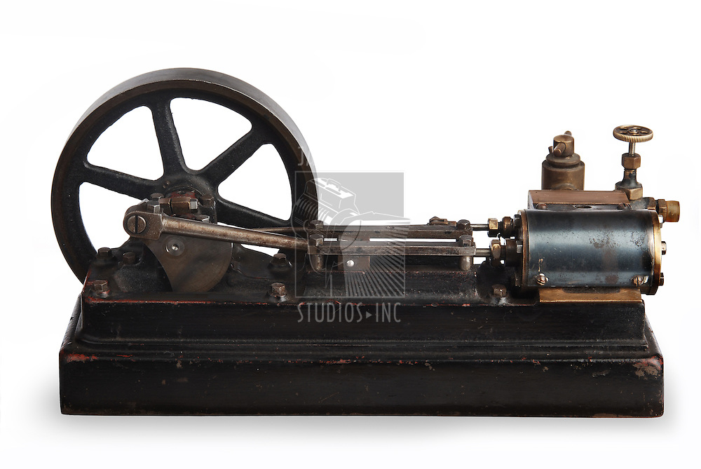 vintage steam piston and flywheel