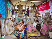 06 SEPTEMBER 2018 - BANGKOK, THAILAND: Indian men in the Ganesh workshop at Wat Witsanu Hindu Temple in Bangkok. Indian craftsmen are making statues of the Hindu deity Ganesha for the Ganesh Chaturthi, or Ganesh Festival, held at Hindu temples in September. All of the craftsmen, and the clay they use to fashion the statues, come to Thailand from India every year to make the statues. Although Thais are predominantly Buddhist, the Lord Ganesh, the Hindu overcomer of obstacles, is worshipped by many Thais and Ganesh Chaturthi is celebrated in many Thai communities.    PHOTO BY JACK KURTZ