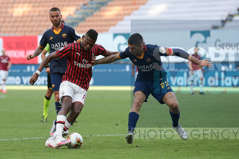 AC Milan's Portuguese striker Rafael Leao is challenged in the area by AS Roma's Italian defender Gianluca Mancini as AS Roma's Italian defender Leonardo Spinazzola looks on during the Serie A match at Giuseppe Meazza, Milan. Picture date: 28th June 2020. Picture credit should read: Jonathan Moscrop/Sportimage