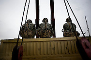 Soldiers sit on a truck as Egyptian anti-government protesters calling for the ouster of President Hosni Mubarak block an Egyptian army armoured personnel carrier (APC) at Tahrir Square in Cairo on February 5, 2011. Protesters sat on the ground around some of the tanks to prevent the troops pulling out and leaving the square vulnerable to the feared interior ministry riot police or militants loyal to Mubarak's ruling National Democratic Party.© ALESSIO ROMENZI