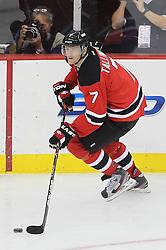 Nov 2; Newark, NJ, USA; New Jersey Devils defenseman Henrik Tallinder (7) skates with the puck during the second period at the Prudential Center.