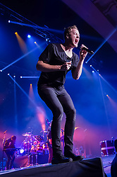 """© Licensed to London News Pictures. 25/11/2013. London, UK.   Imagine Dragons performing live at Brixton Academy. In this pic Dan Reynolds.  Imagine Dragons is an American alternative rock band from Las Vegas consisting of members Dan Reynolds (vocals, Bass drum, Guitar), Ben McKee (Bass, Backing Vocals, Keyboards), Wayne """"Wing"""" Sermon (Guitar, Cello, Backing Vocals), Dan Platzman— Drums, Viola, Backing Vocals.  Photo credit : Richard Isaac/LNP"""