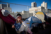 RENO, NV - OCTOBER 6:  Tammy Tyra of Texas stands in a tent city for the homeless in downtown Reno, Nevada October 6, 2008. Tyra works cleaning trucks, but is unable to make enough money to afford housing. The City of Reno set up the tent city when existing shelters became overcrowded as Nevada struggles with one of the highest unemployment rates in the country. (Photo by Max Whittaker/Getty Images)
