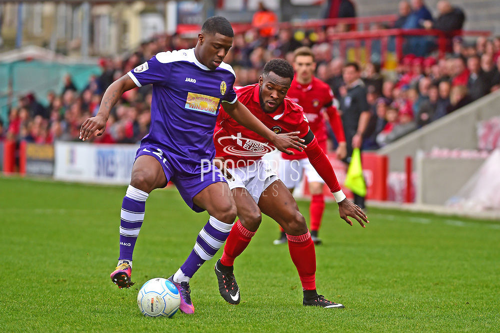 East Thurrock United defender Marvin Ekpiteta (5) defends against Ebbsfleet United forward Bradley Bubb (10) during the Vanarama National League South match between Ebbsfleet United and East Thurrock United at the Enclosed Ground, Whitehawk, United Kingdom on 4 March 2017. Photo by Jon Bromley.