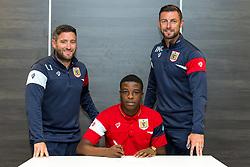 Bristol City Head Coach Lee Johnson and Assistant Head Coach Jamie McAllister look on as Kel Akpobire signs a new contract with Bristol City Under 23s ahead of the 2017/18 Season - Rogan/JMP - 11/07/2017 - Ashton Gate Stadium - Bristol, England.