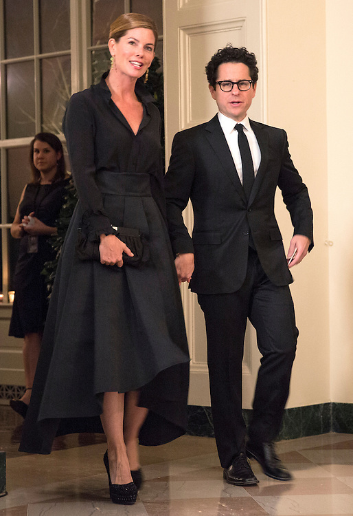 Director J.J. Abrams and Katie McGrath arrive for the State Dinner being held for French President Francois Hollande at the White House in Washington on February 11, 2014.      REUTERS/Joshua Roberts    (UNITED STATES)