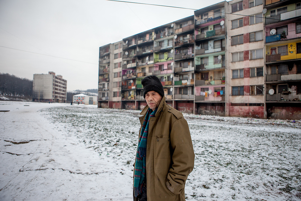 Portrait of Pepa (56) in between high rise buildings at the estate in January 2016. He grew up in Opava - nowadays Czech Republic (former: Czechoslovakia) - and is a long time resident at the Lunik IX housing complex. He was from 1998 for four years the mayor at the local city council at Lunik IX. Lunik IX has officially 6542 registered (12/2015) inhabitants and almost all of them are of Roma ethnicity.