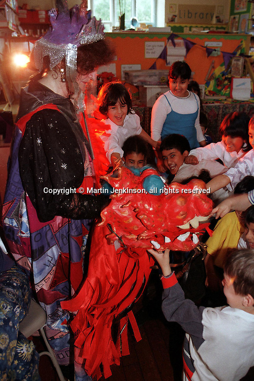 Pupils at a primary school feed the Chinese New Year dragon during a multicultural show  part of Bradford Festival....© Martin Jenkinson tel 0114 258 6808  mobile 07831 189363 email martin@pressphotos.co.uk  NUJ recommended terms & conditions apply. Copyright Designs & Patents Act 1988. Moral rights asserted credit required. No part of this photo to be stored, reproduced, manipulated or transmitted by any means without prior written permission.