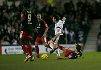 Marc Edworthy of Derby (left) is tackled by Lee Hendrie of Stoke (on ground)
