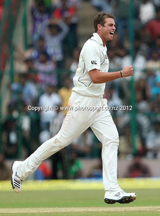 New Zealand cricket tour to India. September 2012 Bengaluru :   NewZealand's Tim Southee with team mates celebrate the wicket of India's Sachin Tendulakr   during the 4th day of the test match against NewZealand in Bengaluru on Monday.