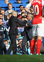Football - 2014 / 2015 Premier League - Chelsea vs. Arsenal<br /> <br /> José Mourinho, Manager, of Chelsea FC ans Arsene Wenger,Manager, of Arsenal FC get physical at Stamford Bridge<br /> <br /> Colorsport/Daniel Bearham