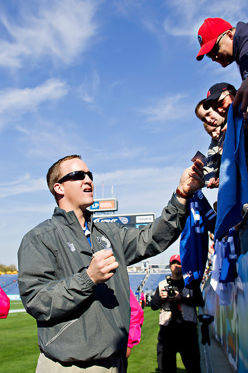 NASHVILLE, TN - OCTOBER 30:   Peyton Manning #18 of the Indianapolis Colts signs autographs before a game against the Tennessee Titans at the LP Field on October 30, 2011 in Nashville, Tennessee.  The Titans defeated the Colts 27 to 10.  (Photo by Wesley Hitt/Getty Images) *** Local Caption *** Peyton Manning