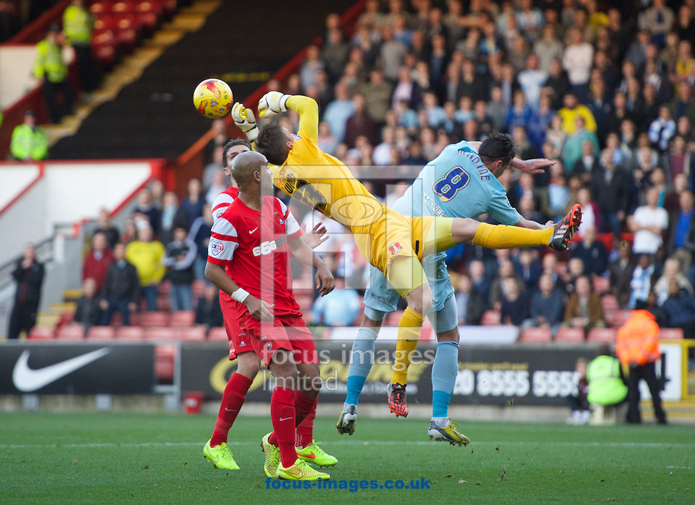 Gary Madine of Coventry City and goalkeeper Gary Woods of Leyton Orient  clash during the Sky Bet League 1 match at the Matchroom Stadium, London<br /> Picture by Alan Stanford/Focus Images Ltd +44 7915 056117<br /> 01/11/2014