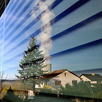 The cooling tower of the G&ouml;sgen Nuclear Power Plant (Kernkraftwerk G&ouml;sgen) reflected in window of a nearby house.  <br />