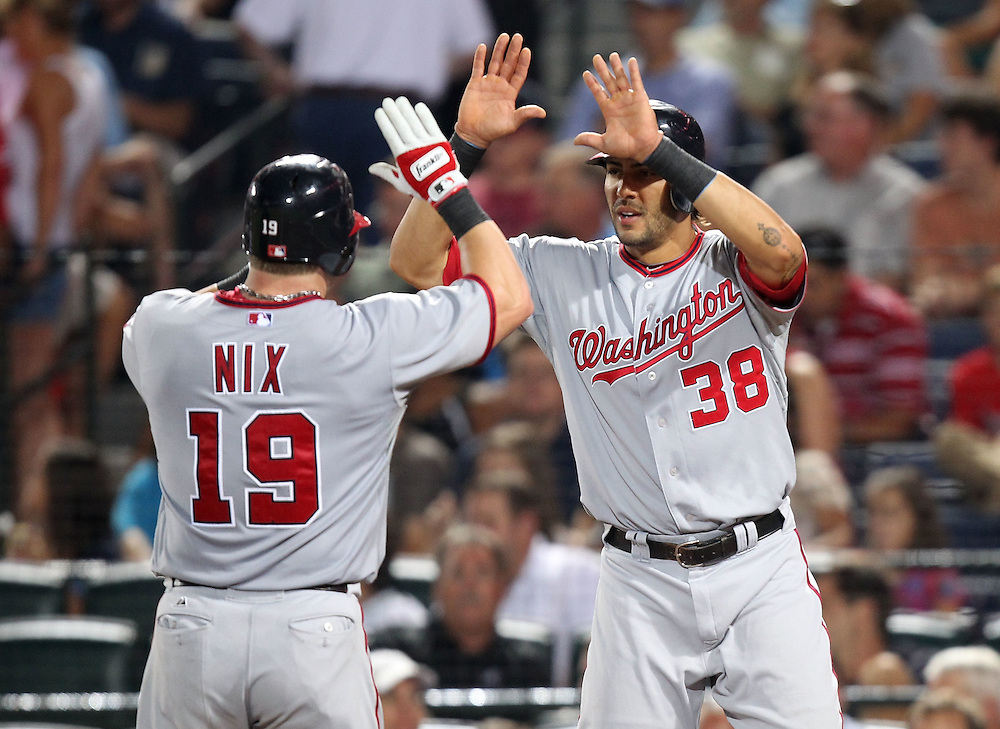 ATLANTA, GA - AUGUST 30:  Right fielder Laynce Nix #19 of the Washington Nationals is congratulated by left fielder Michael Morse after Nix's home run during the game against the Atlanta Braves at Turner Field on August 30, 2011 in Atlanta, Georgia.  (Photo by Mike Zarrilli/Getty Images)
