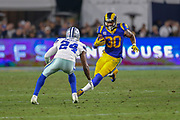 Jan 12, 2019; Los Angeles, CA, USA;  Los Angeles Rams running back Todd Gurley (30) is defended by Dallas Cowboys cornerback Chidobe Awuzie (24) during an NFL divisional playoff game at the Los Angeles Coliseum. The Rams beat the Cowboys 30-22. (Kim Hukari/Image of Sport)