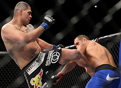 Las Vegas, NV - December 29, 2012: UFC Heavyweight Champion Junior Dos Santos (blue trunks) and challenger Cain Velasquez (black trunks) during their main event bout at UFC 155 at MGM Grand Garden Arena in Las Vegas, Nevada.