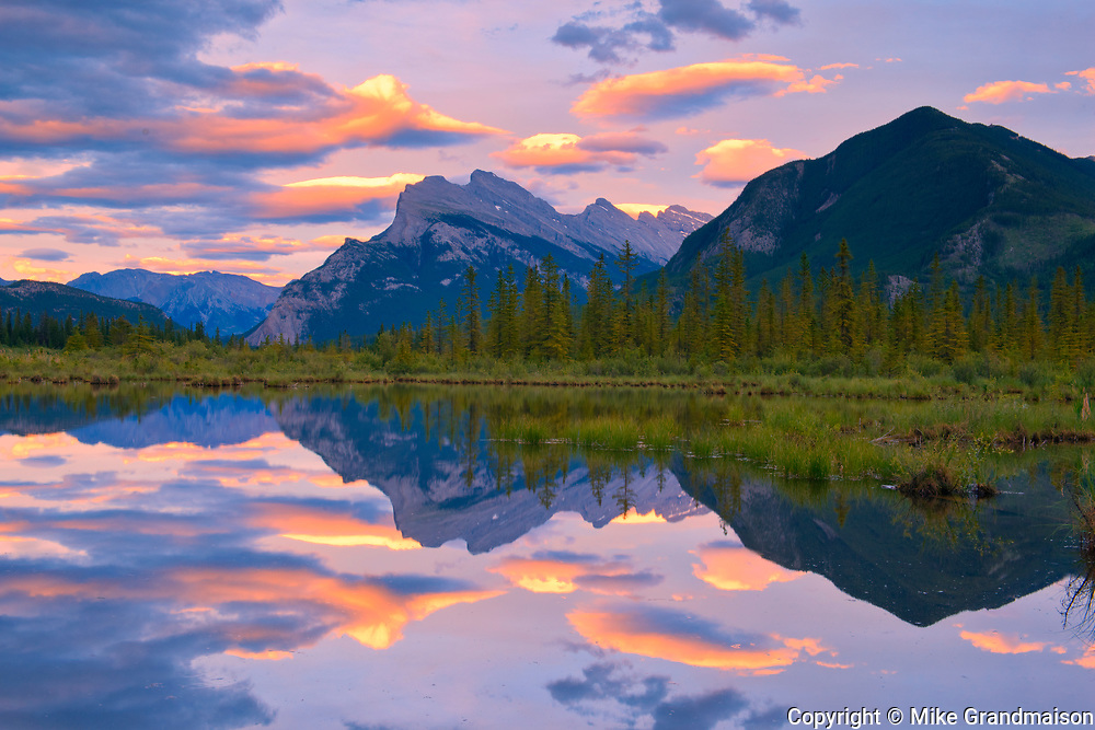 Clouds and Mt. Rundle and Sulphur Mountain reflected in Vermillion Lakes at sunset<br />Banff National Park<br />Alberta<br />Canada