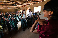 Sasha Kasthuriarachchi during a lesson at the Chisila Community School supported by PEPAIDS, St Mary's, Monze, Zambia. PEPAIDS is a UK-based NGO whose mission is to promote and preserve the health of people in Zambia through the provision of support for HIV/AIDS initiatives and the promotion of awareness of issues surrounding HIV/AIDS. PEPAIDS' local partner NGO is SAPEP, based in the Monze and Mazabuka districts of the Southern Province of Zambia. They work together to empower the rural youth of Zambia to mobilise their communities to fight poverty and HIV/AIDS. SAPEP works with a large number of AIDS Action clubs (AACs) who are trained by SAPEP project staff in subjects such as peer education approaches; gender, customs and traditions; antiretroviral therapy; and counselling. This training empowers the AACs to support the communities in which they are based in the fight against HIV and AIDS. SAPEP encourages AACs to start income generating activities with the goal of being self-reliant and self-sufficient in their mission to alleviate HIV and AIDS. PEPAIDS has designed its training programme to form a cascade in order to reach as many people as possible. Peer educators participate in Training of Trainers workshops, with skills being passed on to club leaders and club members in turn to benefit the wider community. The entire programme is designed to be sustainable, youth-focused, participatory and culturally acceptable.
