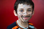 January 27-31, 2016: Daytona 24 hour: A young fan with driver autographs on his face.