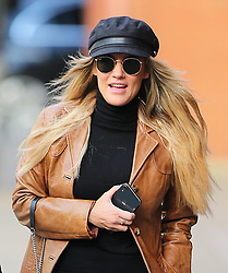 Love Island's presenter Caroline Flack looking sensational, wearing a black cap, shades, brown leather vintage coat, black top, shorts and suede ankle boots arriving at a meeting in central London, UK. 11/12/2019<br /> BYLINE MUST READ : JAMESY/GOTCHA IMAGES<br /> <br /> Copyright by © Gotcha Images Ltd. All rights reserved.<br /> Usage of this image is conditional upon the acceptance <br /> of Gotcha Images Ltd, terms and conditions available at<br /> www.gotchaimages.com
