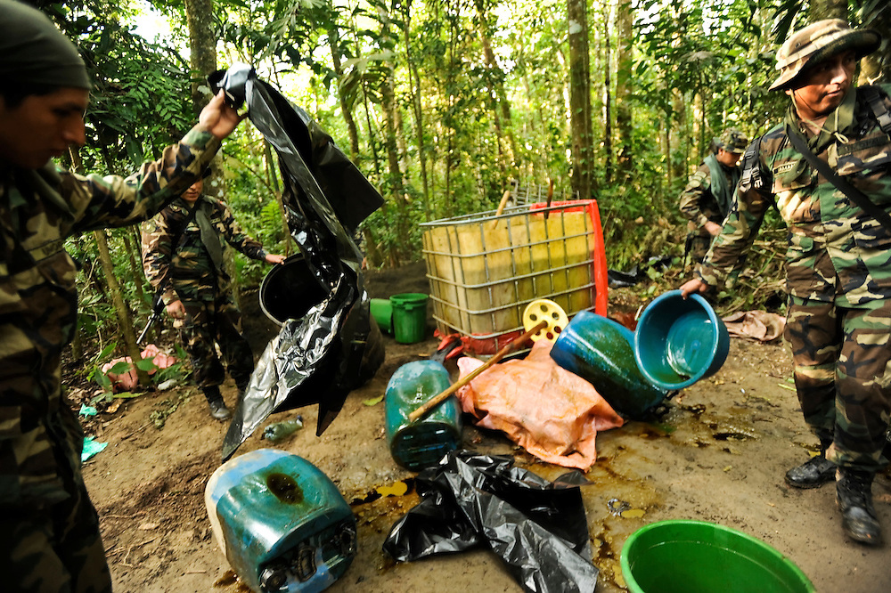 """Bolivian FELCN Special Forces police raid and destroy a cocaine-base processing lab in the outskirts of Villa Nuevo Horizonte, a dangerous area in the department of Santa Cruz were narcotraffiking runs rampant. FELCN officials report it is the area of Bolivia most thickly dense of narcotraffickers and cocaine-base processing laboratories.  FELCN police commonly referred to it as a """"narco pueblo""""."""