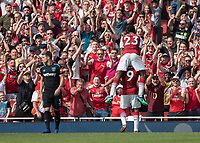 Football - 2017 / 2018 Premier League - Arsenal vs. West Ham United<br /> <br /> Danny Welbeck (Arsenal FC) leaps onto the back of goalscorer Alexandre Lacazette (Arsenal FC) in front of cheering Arsenal fans at The Emirates.<br /> <br /> COLORSPORT/DANIEL BEARHAM
