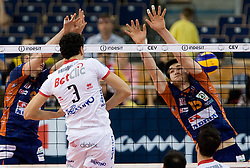 Emanuele Birarelli of Trentino vs Vid Jakopin of ACH at 2nd Semifinal match of CEV Indesit Champions League FINAL FOUR tournament between ACH Volley, Bled, SLO and Trentino BetClic Volley, ITA, on May 1, 2010, at Arena Atlas, Lodz, Poland. Trentino defeated ACH 3-1. (Photo by Vid Ponikvar / Sportida)