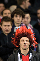 A PSG fan wears a red wig whilst watching the game. Toulouse v Paris St Germain, Ligue 1, Stade Municipal, Toulouse, France, 1st Feb 2013..Credit - Eoin Mundow/Cleva Media, www.clevamedia.com