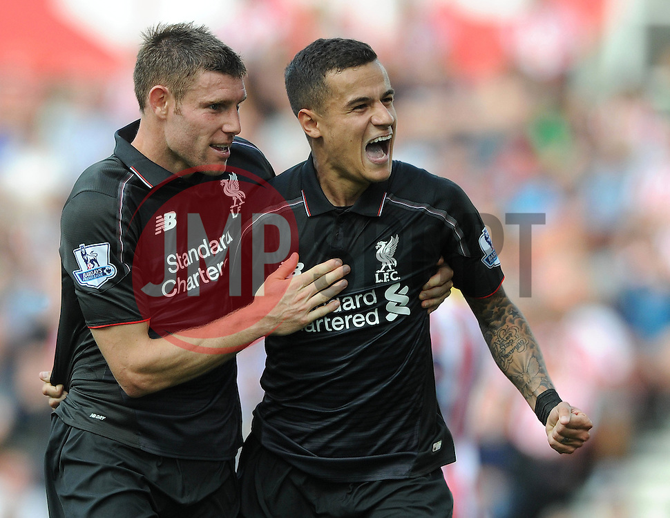Philippe Coutinho of Liverpool celebrates with James Milner of Liverpool - Mandatory byline: Dougie Allward/JMP - 07966386802 - 09/08/2015 - FOOTBALL - Britannia Stadium -Stoke-On-Trent,England - Stoke City v Liverpool - Barclays Premier League