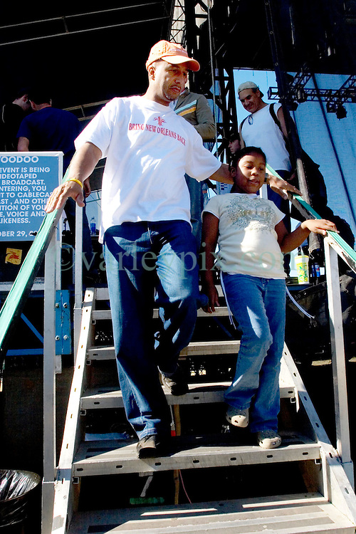 29 Oct, 2005.  New Orleans, Louisiana. Post Katrina.<br />  Let the good times roll. Voodoo Fest tribute concert at Riverview Park. New Orleans Mayor Ray Nagin and his daughter leave the stage.<br /> Photo; &copy;Charlie Varley/varleypix.com