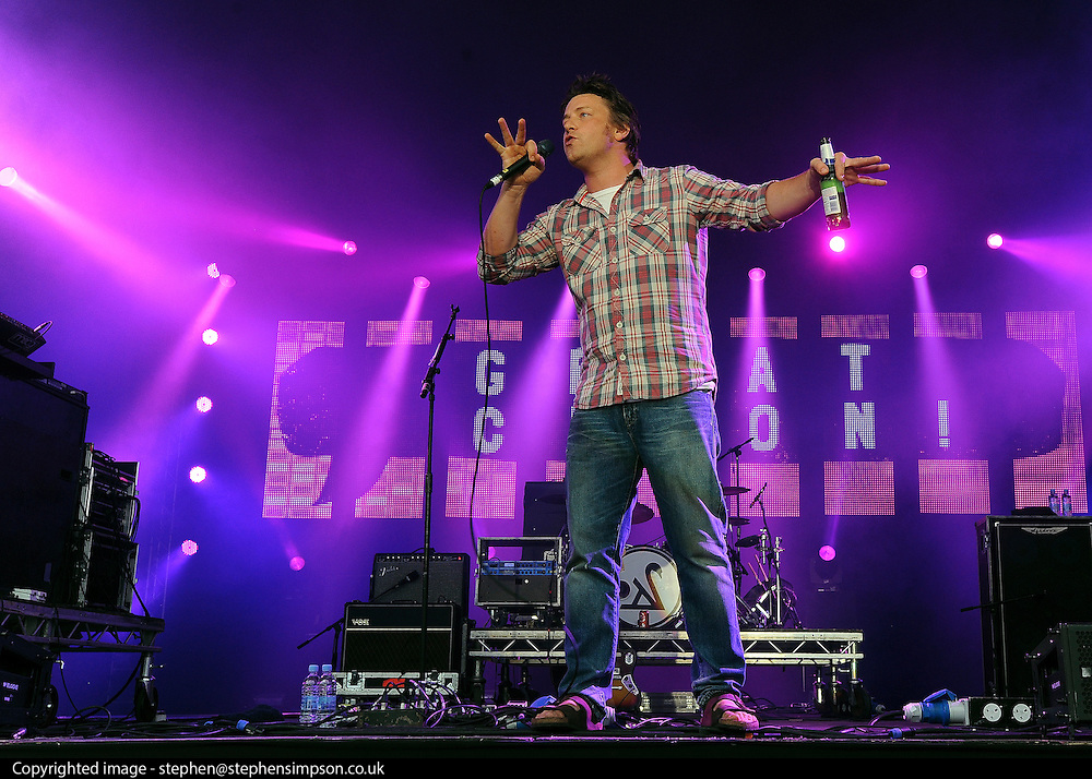 © licensed to London News Pictures. LONDON. UK.  03/07/11. Jamie Oliver introduces Athlete as they  headline at Jamie Oliver's 'The Big Feastival' . Jamie Oliver's The Big Feastival, is a three day event featuring food from some of the country's top chefs along with live music. The Big Feastival takes place on Clapham Common on the 1st, 2nd and 3rd July. All profits from the event will be shared between The Jamie Oliver Foundation and The Prince's Trust.  Mandatory Credit Stephen Simpson/LNP