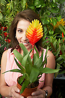Woman Holding Tropical Plant