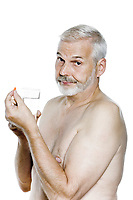 caucasian man portrait take medecine pill annoyed isolated studio on white background