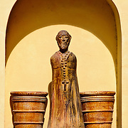 Detail of sculpture and buckets design in a yellow stucco wall in Valladolid, Yucatan, Mexico