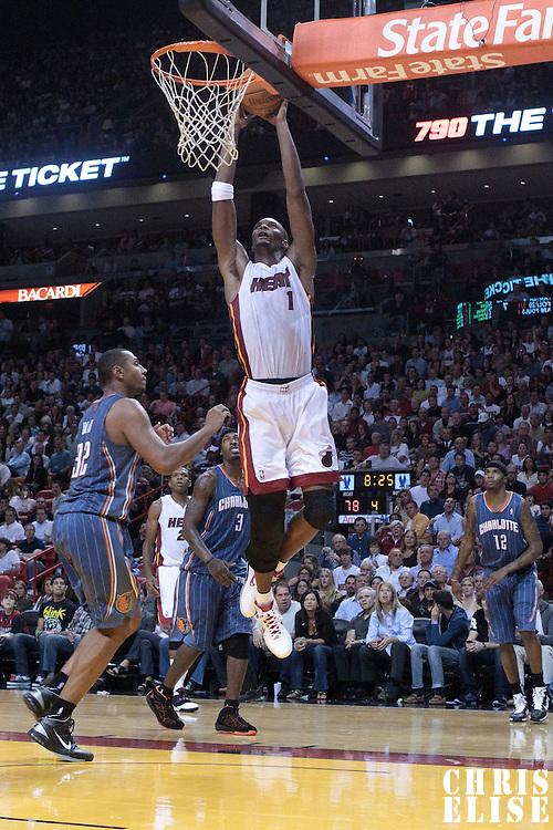 19 November 2010: Miami Heat's power forward #1 Chris Bosh dunks the ball on Charlotte Bobcats' power forward #32 Boris Diaw during the Miami Heat 95-87 victory over the Charlotte Bobcats at the AmericanAirlines Arena, Miami, Florida, USA.