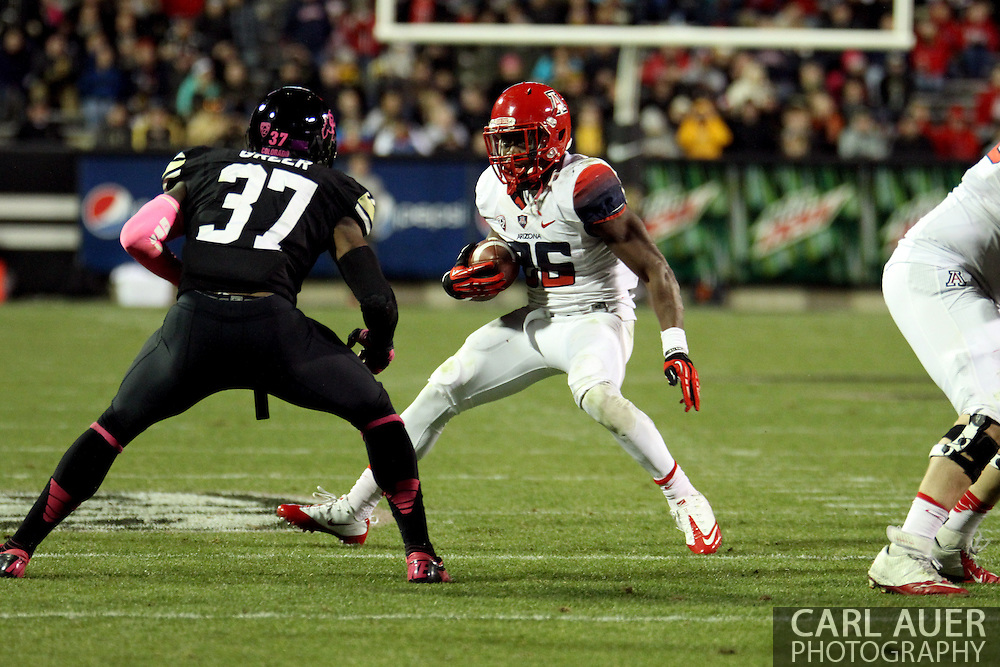 October 26th, 2013:  University of Arizona Wildcats junior running back Ka'Deem Carey (25) attempts to side step Colorado Buffaloes junior outside linebacker Woodson Greer III (37) in fourth quarter action of the NCAA football game between the University of Arizona Wildcats and the University of Colorado Buffaloes at Folsom Field in Boulder, Colorado