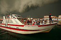 Marina at Stes. Marie de Mer, in the Camargue of Provence, France..a tour boat arrives in port and so does an arriving sudden storm..Photo by Owen Franken for the NY Times..October 6, 2007..Assignment ID: 30049869A
