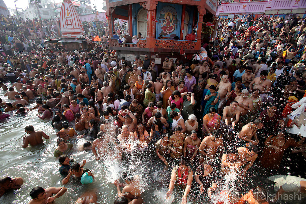 Hindu devotees take dip in the holy Ganges River during Kumbh Mela in Haridwar, northern India on January 2010. Hindus believe that bathing in the Ganges during the festival, the largest Hindu gathering in the world, cleanses them of sin. Photo by Kuni Takahashi