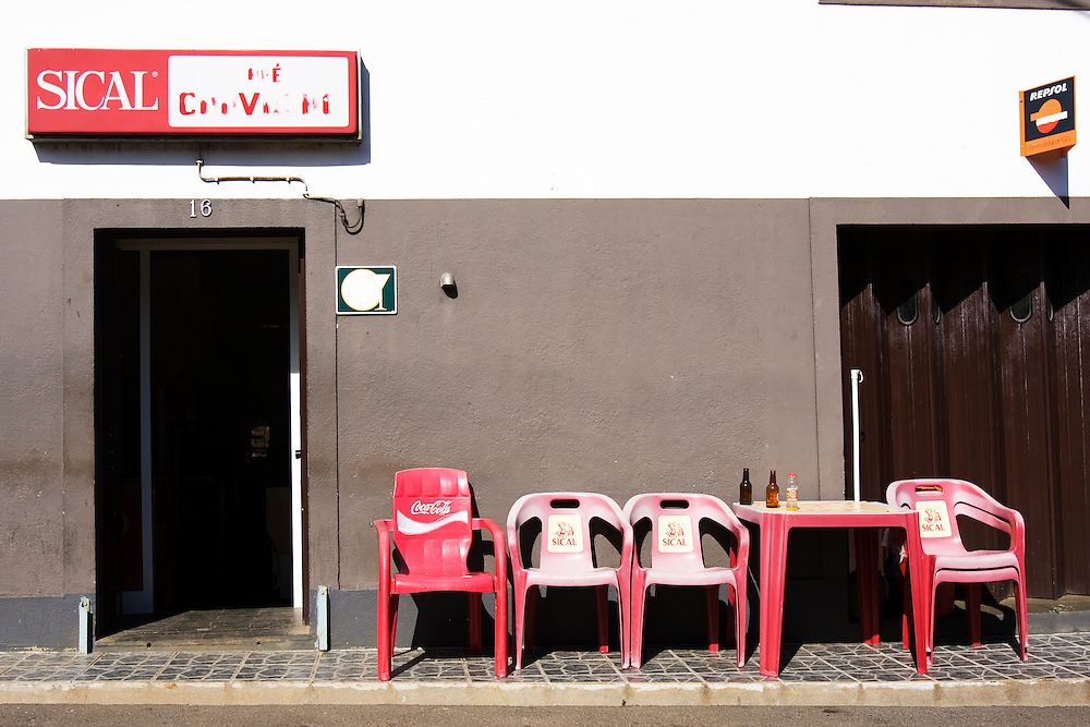 A row of empty plastic chairs outside of a cafe on the Portuguese Island Of Faial. The Azores are a group of nine islands under Portuguese sovereignty. They mark the most westerly point of the E.U. and earn most of their income from agriculture and tourism.