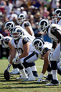 Los Angeles Rams center Aaron Neary (72) gets set to snap the ball as he lines up at the line of scrimmage with the Rams offensive line during the 2018 NFL preseason week 2 football game against the Oakland Raiders on Saturday, Aug. 18, 2018 in Los Angeles. The Rams won the game 19-15. (©Paul Anthony Spinelli)