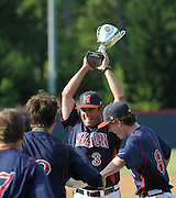 Milton coach Joey Ray (3) celebrates the 2-1 win over Roswell in their GHSA AAAAAA State Baseball Championship game, Monday, May 27, 2013, in Milton, Ga.   David Tulis/dtulis@gmail.com
